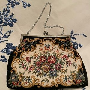 Needle point purse with silver chain handle.